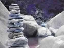 Meditation erfüllt mehr als Wünsche aufgestapelte Steine